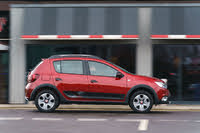 2013 Dacia Sandero Stepway, 2013-2020 Dacia Sandero Stepway red, side profile, driving, gallery_worthy