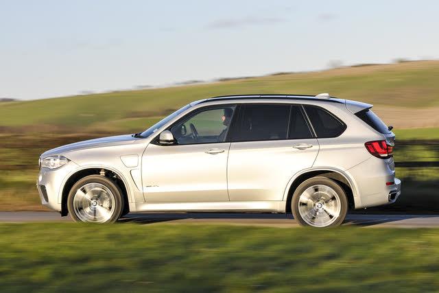 2014-2018 BMW X5 (F15), silver, side profile, driving